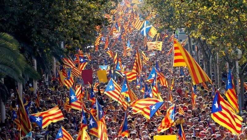 People hold  Catalan separatist flags known as