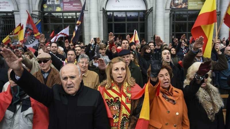 2015-11-22 14:58:54 Supporters of the Spanish dictator Francisco Franco perform the fascist salute as they take part in a demonstration to pay tribute to the dictator in the 40th Anniversary of his death, at Plaza de Oriente on November 22, 2015 in Madrid. Franco came to power after his side won Spain's 1936-39 civil war with the help of Germany's Adolph Hitler and Italy's Benito Mussolini. He then ruled Spain with an iron fist until his death on November 20, 1975. Forty years after the death of Francisco Franco, historians still work to demolish myths that the Spanish dictator spun about himself to hold on to power for decades.  AFP PHOTO/ PEDRO ARMESTRE
